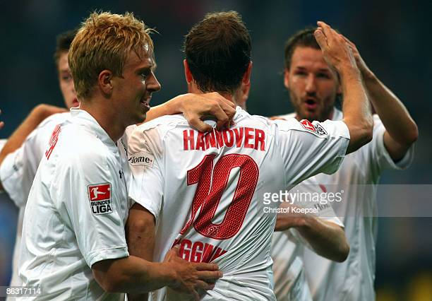 Arnold Bruggink of Hannover celebrates his first goal with Mike Hanke and Christian Schulz during the Bundesliga match between VfL Bochum and...