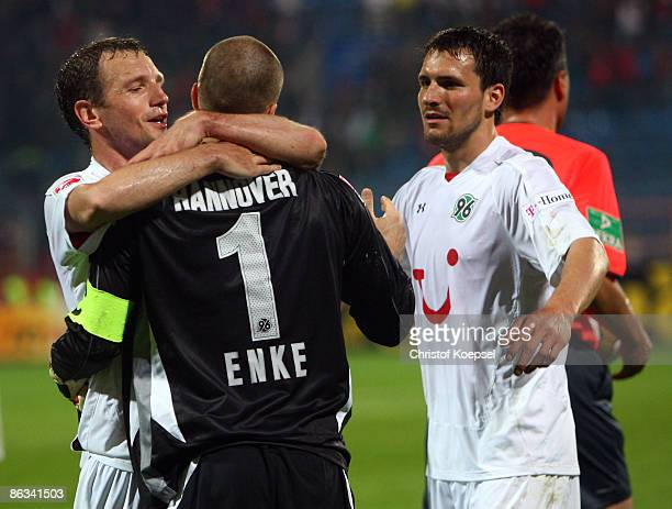 Arnold Bruggink Robert Enke and Mario Eggimann of Hannover celebrate the 20 victory after the Bundesliga match between VfL Bochum and Hannover 96 at...