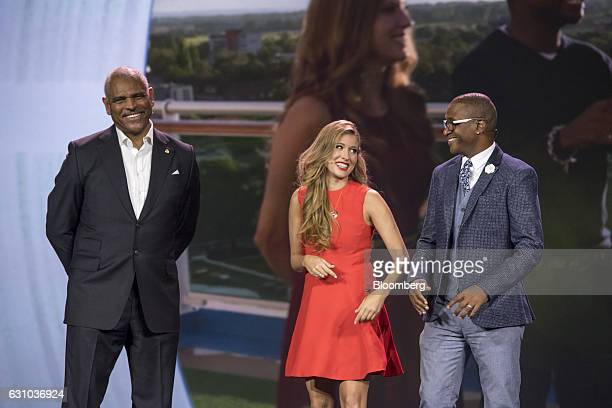 Arnold Donald president and chief executive officer of Carnival Corp from left smiles on stage with Andrea Feczko and Tommy Davidson hosts of...