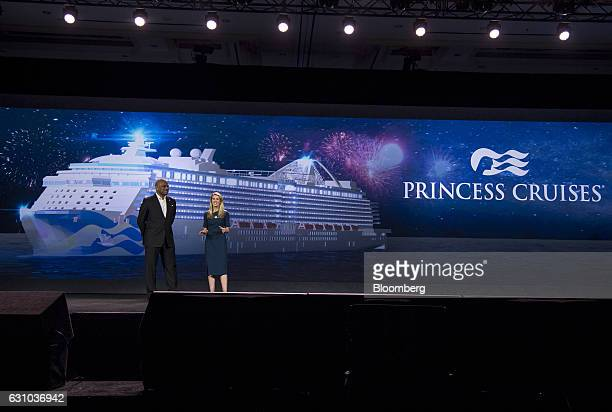 Arnold Donald president and chief executive officer of Carnival Corp left listens as Jan Swartz group president of Princess Cruises and Carnival...