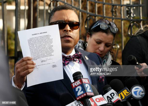 Arnold E Reed attorney for US Rep John Conyers holds an affidavit from James Marbury refuting Conyer's accuser Marion Brown's claim outside Conyers...