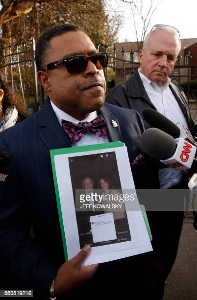 Arnold E Reed attorney for US Rep John Conyers holds holds up a photo to reporters of Conyer's accuser Marion Brown from the 2011 Barristers Ball...