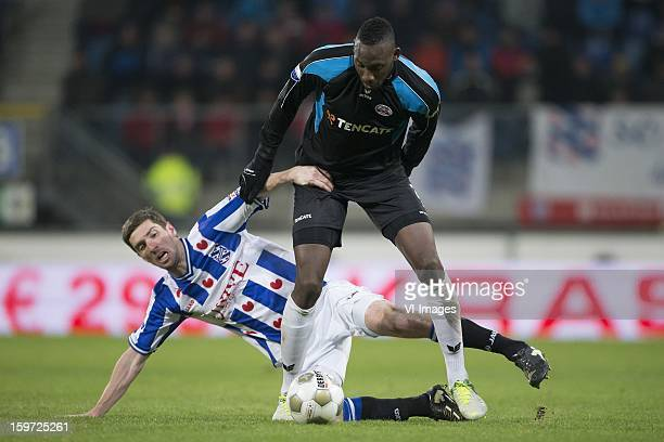 Arnold Kruiswijk of sc Heerenveen Geoffrey Castillion of Heracles Almelo during the Dutch Eredivise match between SC Heerenveen and Heracles Almelo...