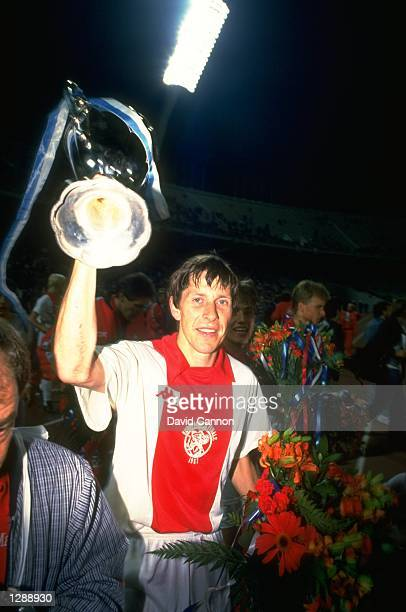 Arnold Muhren of Ajax holds holds the trophy aloft after the European Cup Winners Cup final against Leipzig at the Olympic Stadium in Athens Greece...