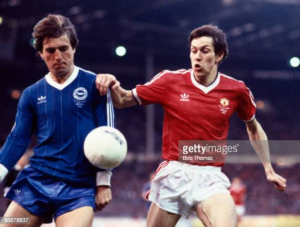 Arnold Muhren of Manchester United challenges Brighton's Steve Gatting during the FA Cup Final replay between Brighton and Manchester United held at...