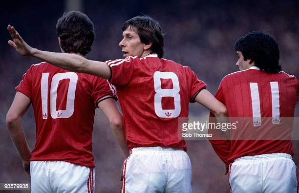 Arnold Muhren organises Manchester United's defensive wall with Norman Whiteside and Alan Davies during the FA Cup Final replay between Brighton and...