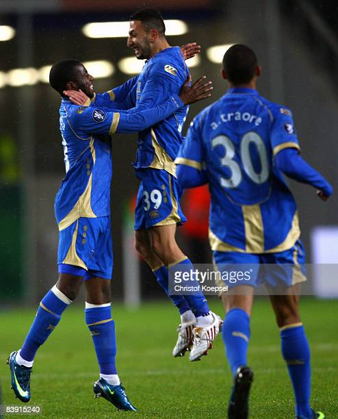 Arnold Mvuemba Makengo of Portsmouth celebrates the second goal with Nadir Belhadj during the UEFA Cup Group E match between VfL Wolfsburg and...