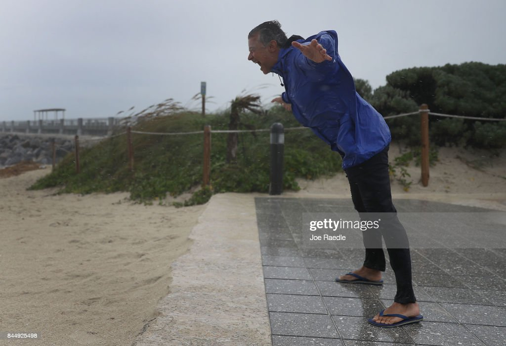 Arnold Naintre leans into the winds as Hurricane Irma approaches on September 9, 2017 in Miami Beach, Florida. Florida is in the path of the Hurricane which may come ashore at category 4.