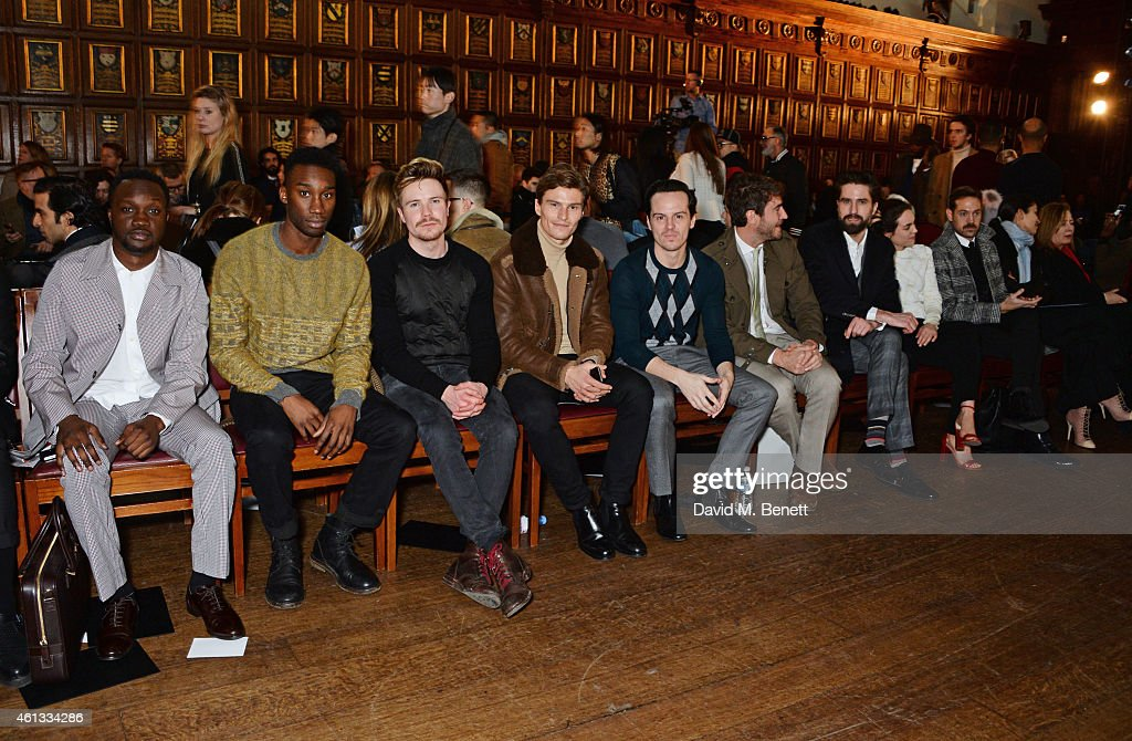 Arnold Oceng, Nathan Stewart-Jarrett, Joe Dempsie, Oliver Cheshire, Andrew Scott, Robert Konjic, Jack Guinness and Tallulah Harlech attend the Pringe Of Scotland Autumn/Winter 2014 menswear runway show during London Collections: Men at Middle Temple Hall on January 11, 2015 in London, England.