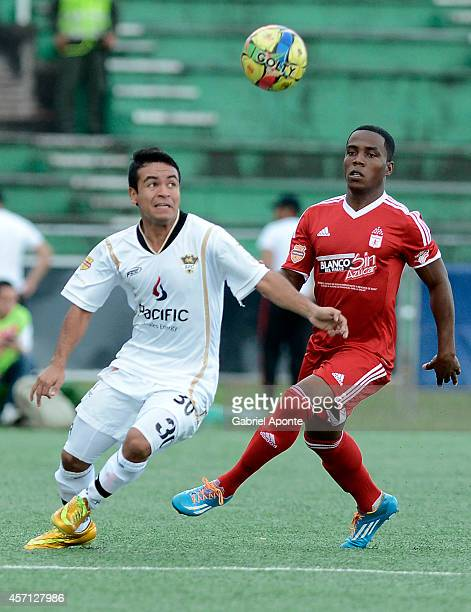 Arnold Palacios of America de Cali struggles for the ball with Enrique Soto of Llaneros FC during a match between America de Cali and Llaneros FC as...