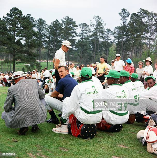 Arnold Palmer and a plethora of caddies during the 1965 Masters Tournament at Augusta National Golf Club in April 1965 in Augusta Georgia