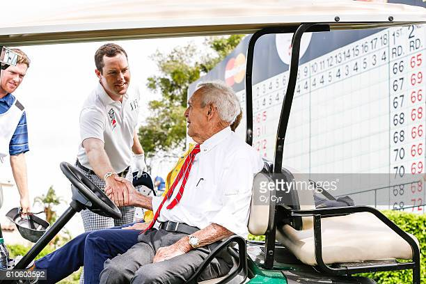 Arnold Palmer and his wife Kathleen 'Kit' Palmer greet Kyle Reifers on the 16th hole during the final round of the Arnold Palmer Invitational...