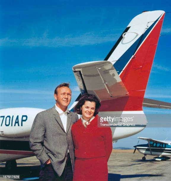 Arnold Palmer and his wife pose in front of their personal airplane around 1965 in Latrobe Pennsylvania