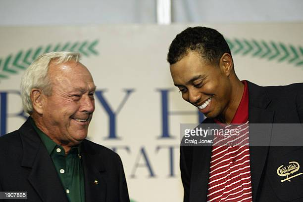 Arnold Palmer congratulates Tiger Woods after the final round of the Bay Hill Invitational on March 23, 2003 at the Bay Hill Club and Lodge in...