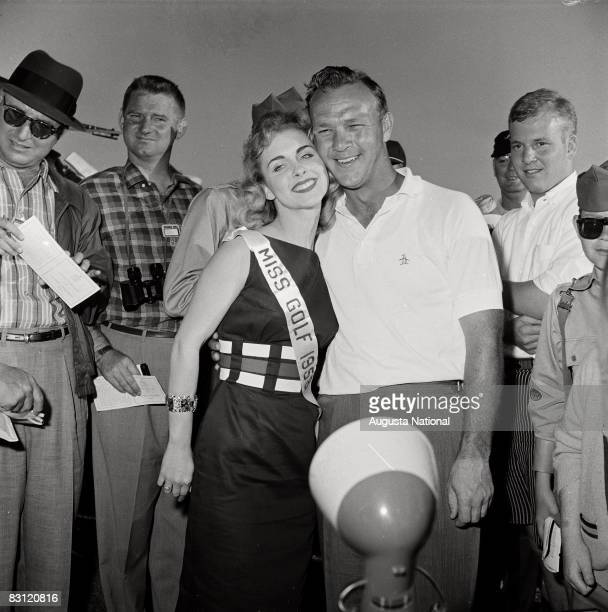Arnold Palmer gets a hug from Miss Golf during the 1958 Masters Tournament at Augusta National Golf Club in April 1958 in Augusta, Georgia.