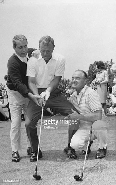 Arnold Palmer gets a lot of expert advice from Perry Como and Bob Hope on the number one tee before the start of their charity exhibition game in...