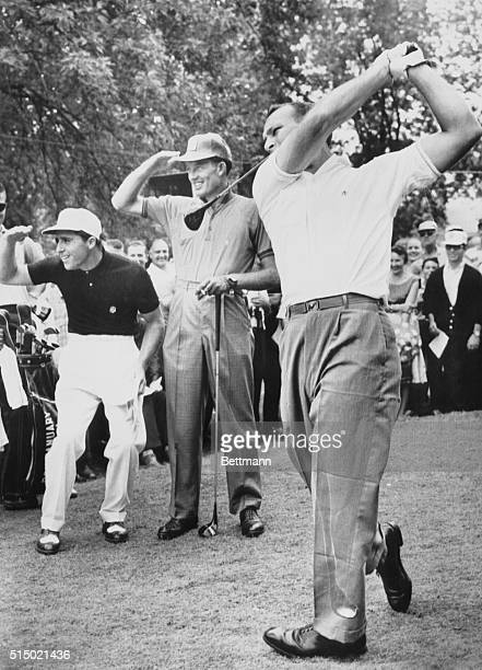 Arnold Palmer hits a tee shot on the first tee under the watchful eyes of Gary Player and Don January during the 43rd PGA Tourney at Olympia Fields...