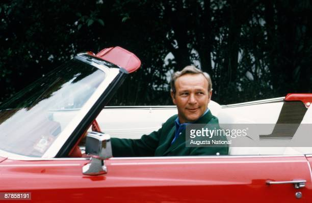 Arnold Palmer in his red Cadillac during the 1973 Masters Tournament at Augusta National Golf Club in April 1973 in Augusta Georgia