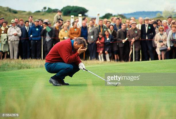 Arnold Palmer is shown holding his head as he kneels on the 3rd green, during the 97th British Open Golf Championship.
