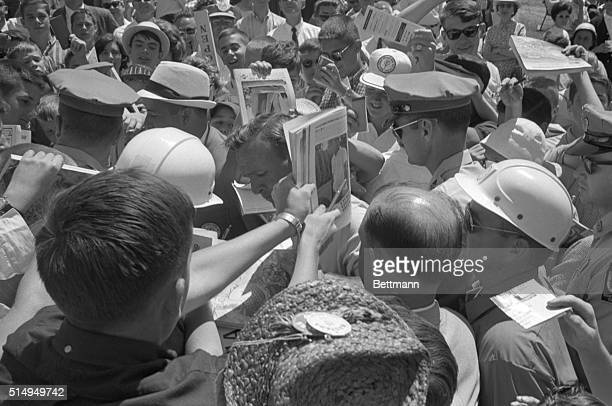 Arnold Palmer is surrounded by the troops of 'Arnies's Army' after he finishes a practice round at the Congressional Country Club in preparation for...