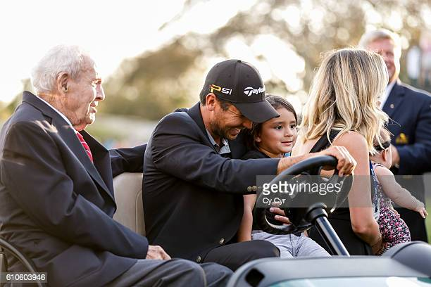 Arnold Palmer Jason Day of Australia Dash Day Ellie Day and Lucy Day laugh during a photo call following Day's one stroke victory on the 18th hole...
