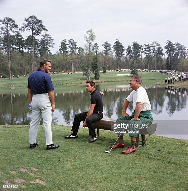 Arnold Palmer left talks with Gary Player center and Jimmy Demaret on the Par 3 Course during the 1965 Masters Tournament at Augusta National Golf...