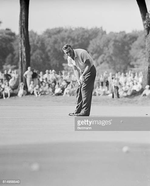 Arnold Palmer making his putt on the 18th green to within a few inches of the cup and close enough for a cinch par four so that he and Sweeny...