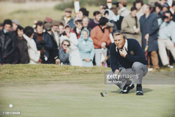 Arnold Palmer of the United States follows his ball onto the green during the Four ball competition of the 20th Ryder Cup Matches against the United...