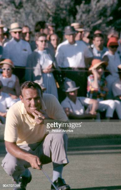 Arnold Palmer of the United States looks to line up his putt during the 1962 Tournament of Champions on May 6, 1962 in Las Vegas, Nevada.