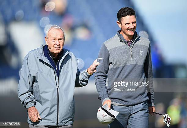 Arnold Palmer of the United States walks alongside Justin Rose of England during the Champion Golfers' Challenge ahead of the 144th Open Championship...