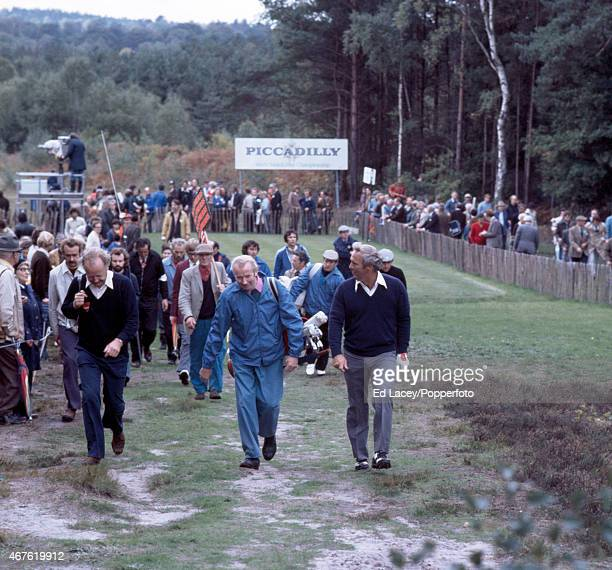 Arnold Palmer of the United States with his caddy, followed by spectators, at the Piccadilly World Match Play Championship at Wentworth Golf Club in...