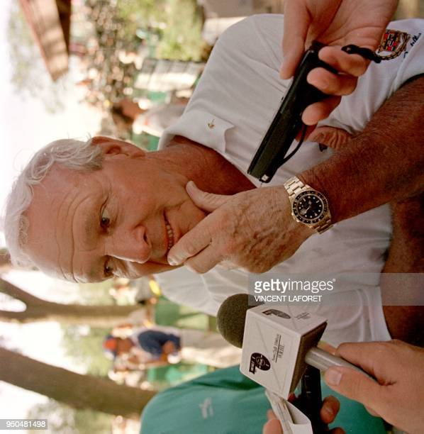 Arnold Palmer of the US talks to the press after finishing six over par 27 June in the second round of the US Senior Open golf tournament at Olympia...