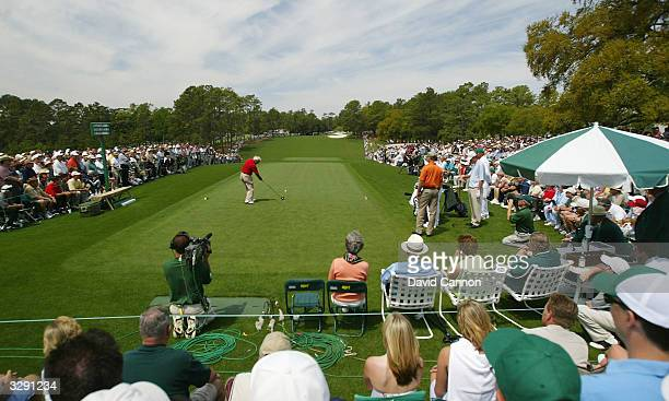 Arnold Palmer of the USA plays his tee shot on the first hole during the second round of the Masters at the Augusta National Golf Club on April 9...