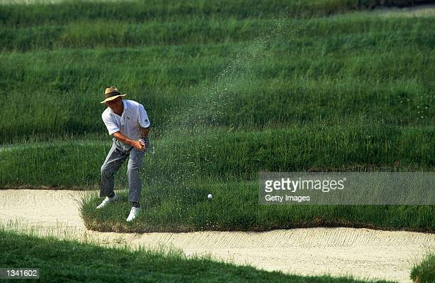 Arnold Palmer of the USA plays out of the infamous Church Pews Bunker during the US Open at Oakmont Country Club in Pennsylvania USA on June 16 1994