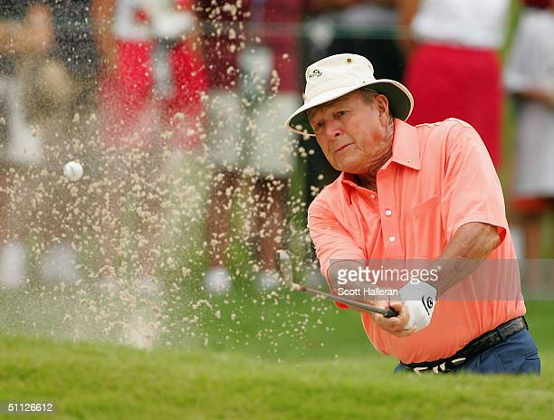 Arnold Palmer plays a bunker shot on the second hole during the first round of the 25th US Senior Open at Bellerive Country Club on July 29 2004 in...