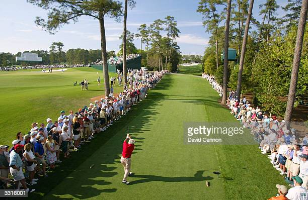 Arnold Palmer plays his tee shot on the 18th hole during the second round of the Masters at the Augusta National Golf Club on April 9, 2004 in...