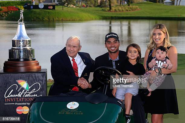 Arnold Palmer poses with Jason Day of Australia his wife Ellie and children Dash and Lucy following the final round of the Arnold Palmer Invitational...