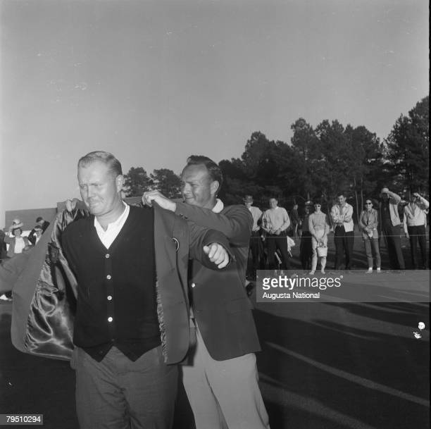 Arnold Palmer Puts The Green Jacket On Jack Nicklaus During The Presentation Ceremony Of The 1965 Masters Tournament