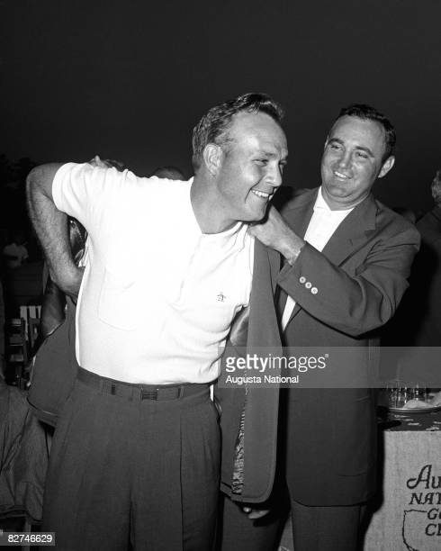 Arnold Palmer receives the green jacket from Doug Ford during the Presentation Ceremony at the 1958 Masters Tournament at Augusta National Golf Club...