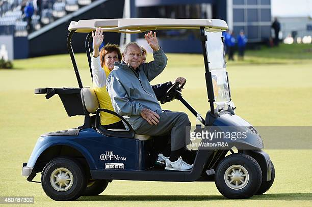 Arnold Palmer rides in a golf cart with his wife Kathleen during the Champion Golfers' Challenge ahead of the 144th Open Championship at The Old...