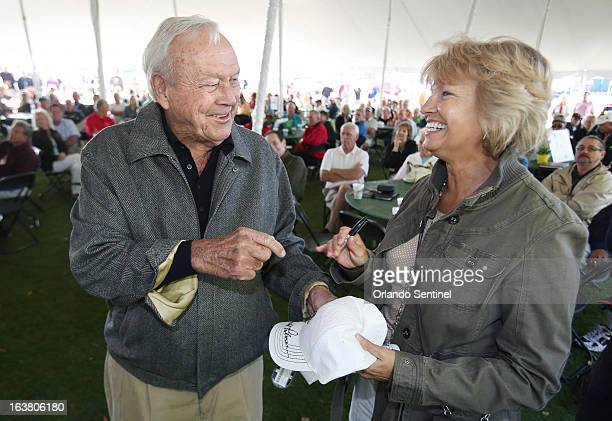 Arnold Palmer signs hats for volunteer Mona MacDonald during a volunteer appreciatiion breakfast at the Bay Hill Club Lodge in Orlando Florida...