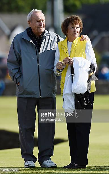 Arnold Palmer stands with his carm around his wife Kathleen during the Champion Golfers' Challenge ahead of the 144th Open Championship at The Old...
