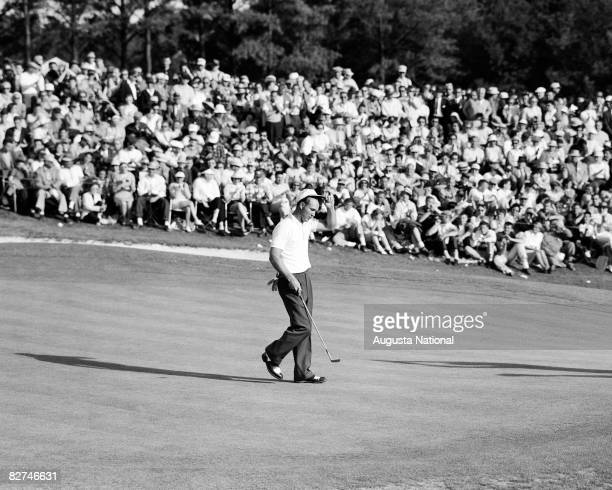 Arnold Palmer tips his hat to the gallery of patrons on the 18th green during the 1958 Masters Tournament at Augusta National Golf Club held APril 36...