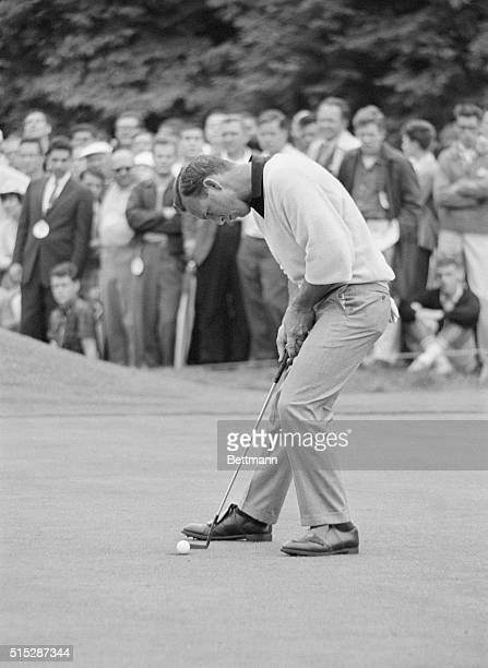 Arnold Palmer watches his put sink during second round play of the Thunderbird Classic Invitational at the Westchester Country Club Following two...
