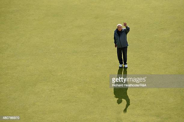 Arnold Palmer waves on the 18th green during the Champion Golfers' Challenge ahead of the 144th Open Championship at The Old Course on July 15 2015...