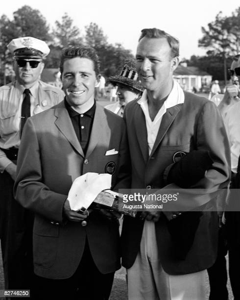 Arnold Palmer wears his green jacket while standing with runnerup Gary Player at the Presentation Ceremony during the 1962 Masters Tournament at...
