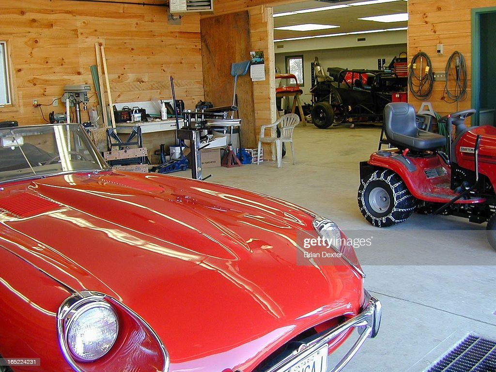 Arnold Roper, 61, with his huge garage, cars, stock car racing trophies,boys room and chiropractic o : News Photo