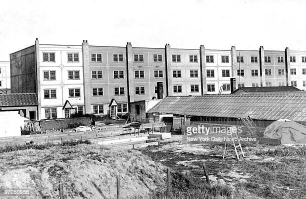 Arnold Rothstein village on Juniper Avenue in Maspeth and Middle Village Queens Buildings which Mayor Fiorello LaGuardia charges were never meant to...