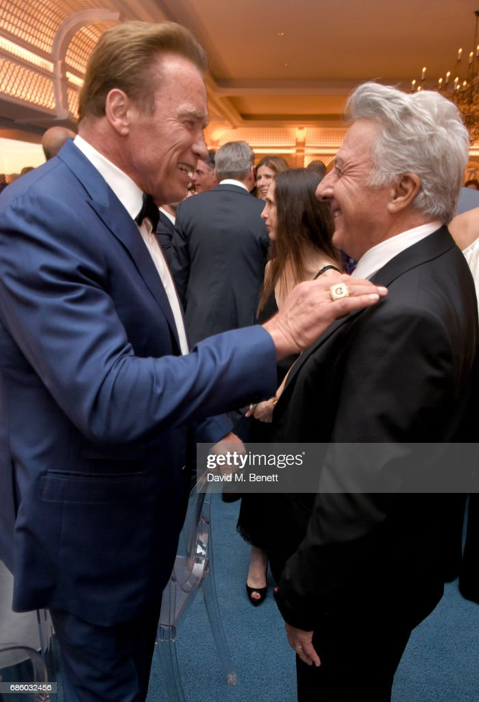 Arnold Schwarzenegger (L) and Dustin Hoffman attend the Vanity Fair and HBO Dinner celebrating the Cannes Film Festival at Hotel du Cap-Eden-Roc on May 20, 2017 in Cap d'Antibes, France.