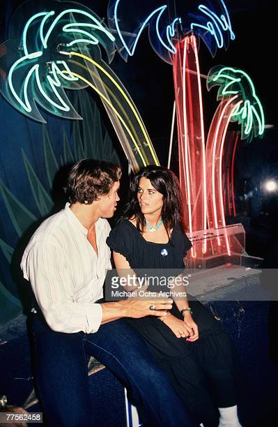 Arnold Schwarzenegger and future wife Maria Shriver chat at a Kennedy Family campaign rally for Senator Ted Kennedy's 1980 Presidential bid on June 1...